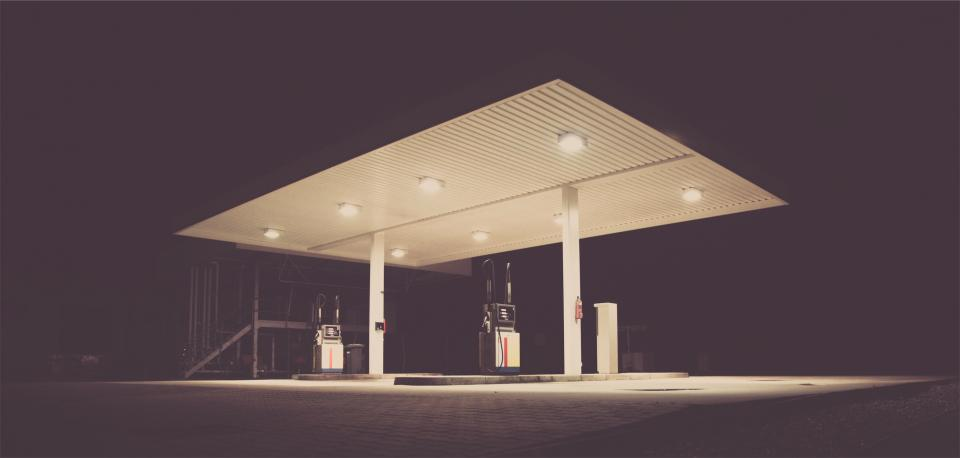 gas station service station pumps dark night