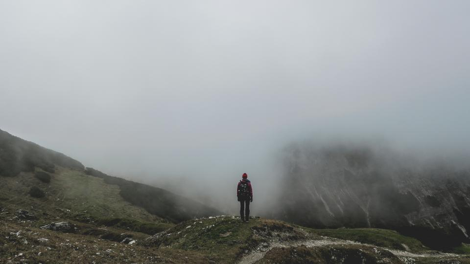 guy man male people back stand contemplate nature mountains summit peaks travel trek hike climb fog