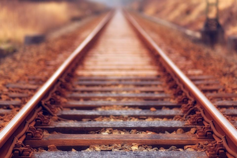 railway track outdoor travel outdoor blur sunset