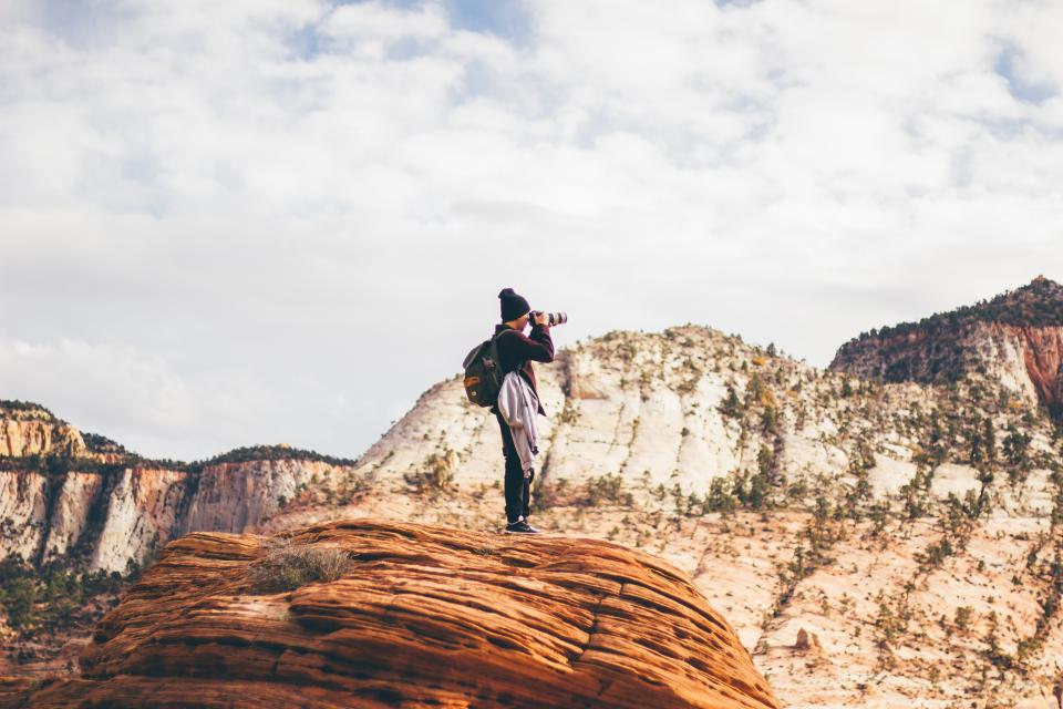 photographer photography camera people landscape nature canyons sky clouds backpack