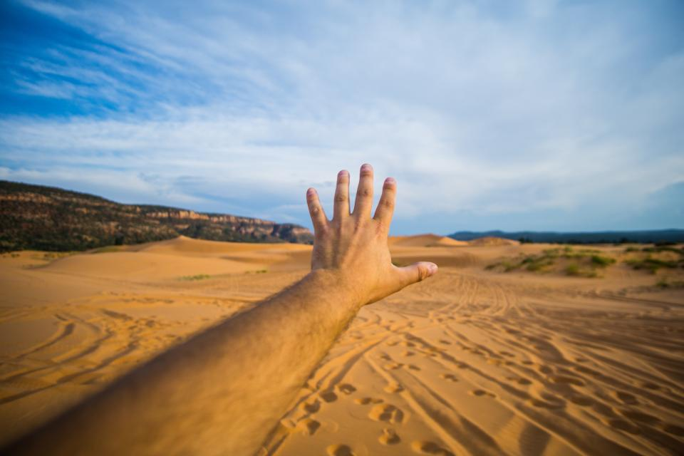 blue sky mountain sand desert footprint travel adventure hand arm