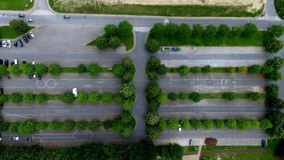 aerial view green trees plant car parking lot road transportation