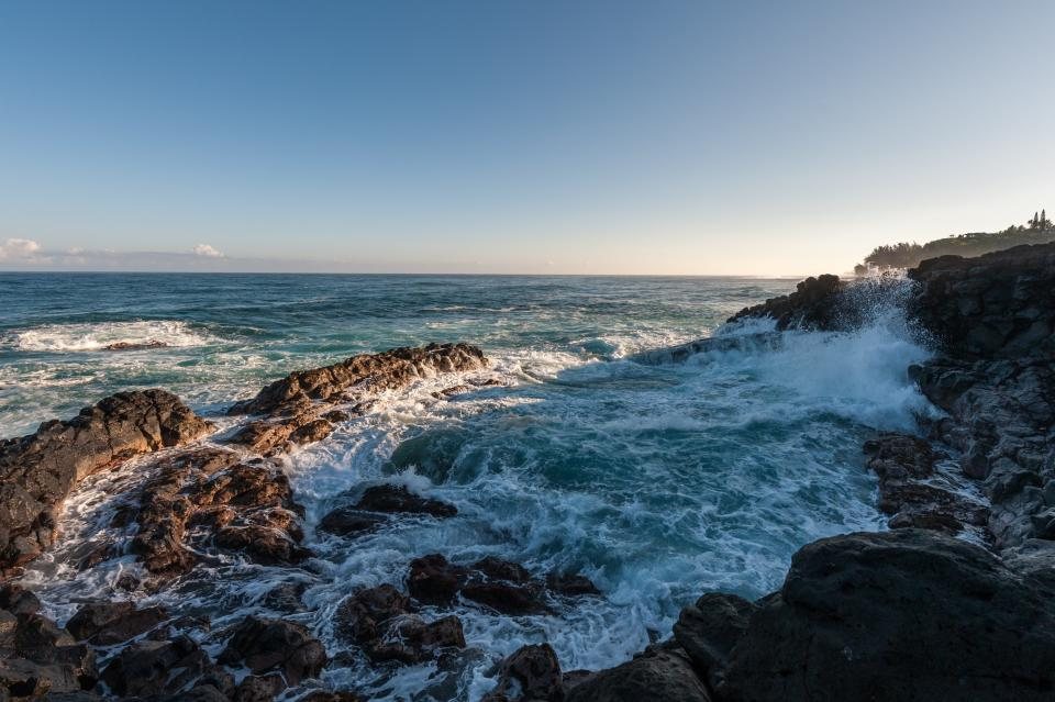 clouds blue sky ocean sea crashing water nature waves coast rocks hill