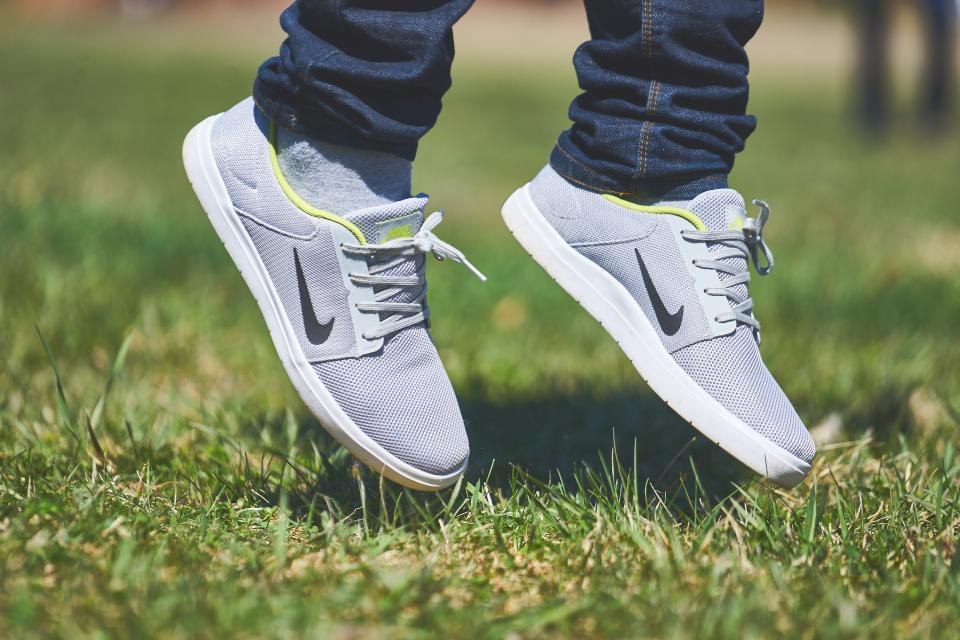 nike shoes sneakers jump jumping green grass lawn outdoors nature