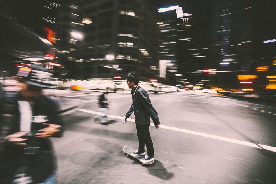 skateboard skateboarding skater people streets roads city urban night dark evening intersection lifestyle buildings lights