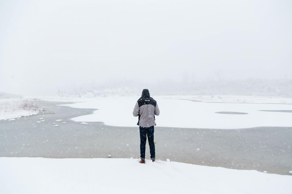 people man alone snow winter cold weather jacket fog