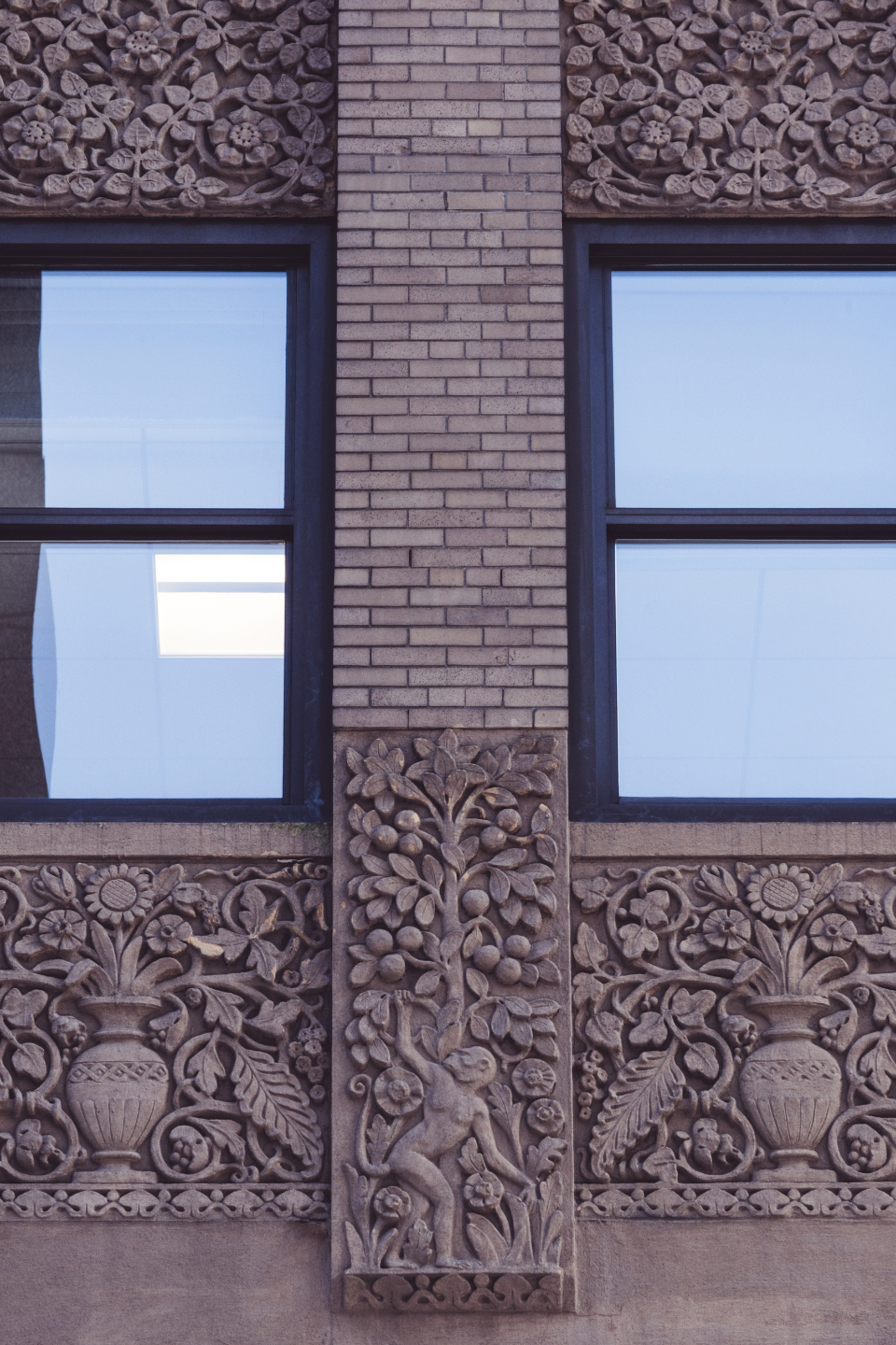 building ornate detail windows brick sculpture city exterior glass design art architecture symmetry stone urban