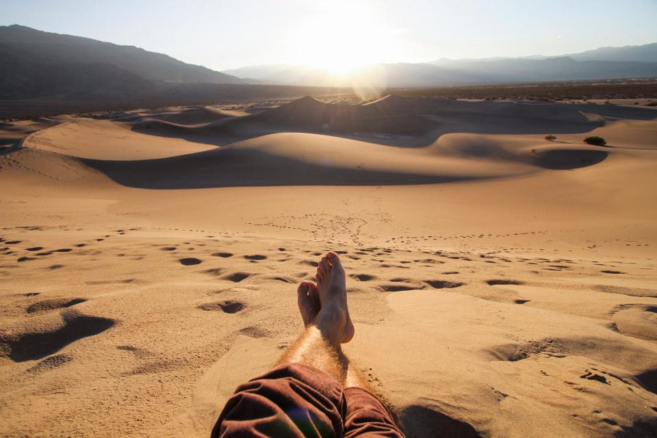 chill relax people man sunset dessert sun mountain sand footsteps