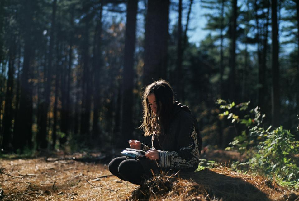 girl reading forest trees long hair brunette people nature sunny