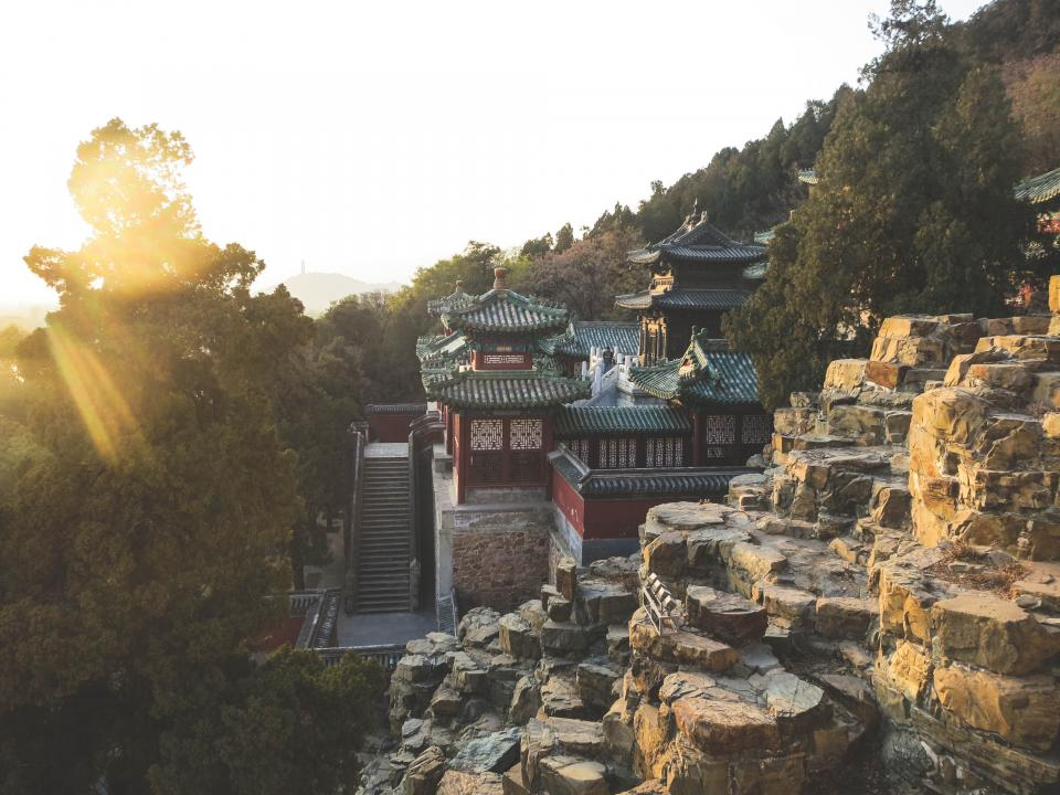 Summer Palace Beijing China rocks cliffs steps trees hill roof sunshine
