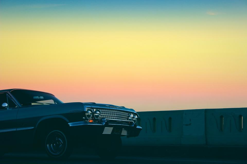 sunset dusk sky yellow car automotive vintage oldschool low rider road street driving
