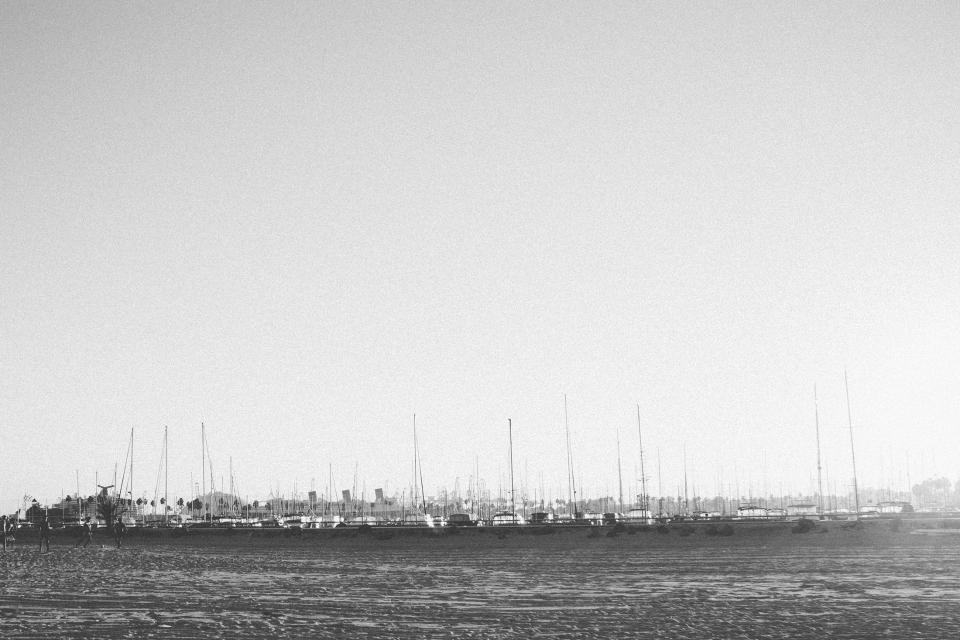 beach harbor harbour boats sailboats black and white