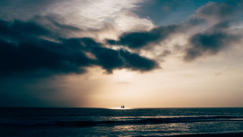 dark clouds sky horizon boat sailing sea ocean water waves nature