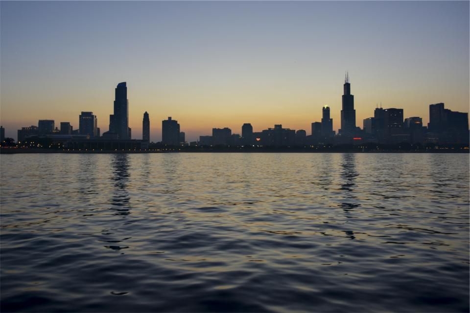 sunset buildings skyline architecture water high rises towers dusk night