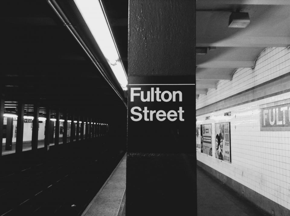 Fulton Street NYC subway station transportation platform urban New York City black and white