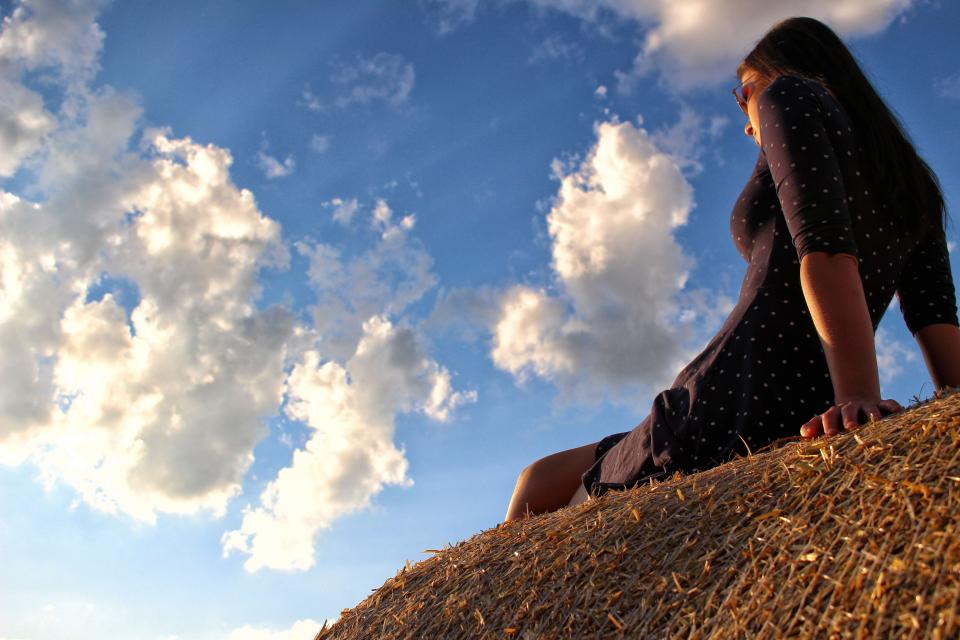 people woman female girl grass relax blue sky cloud
