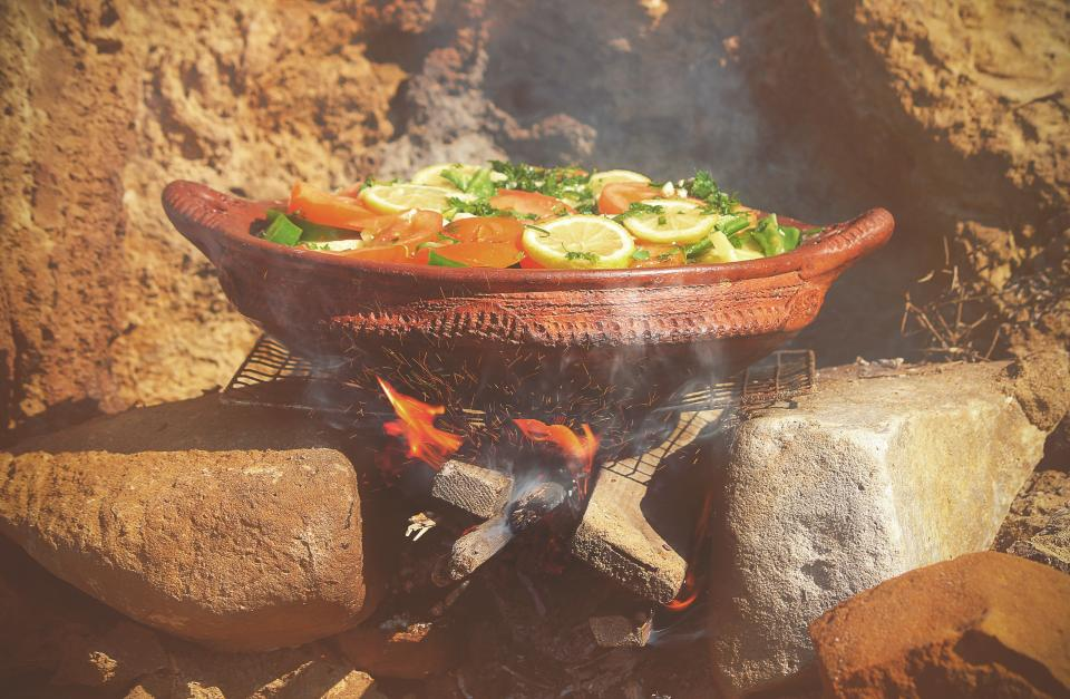pot grill charcoal outdoor fire sparks smoke rocks tomato green lemon vegetable food cook boil camp