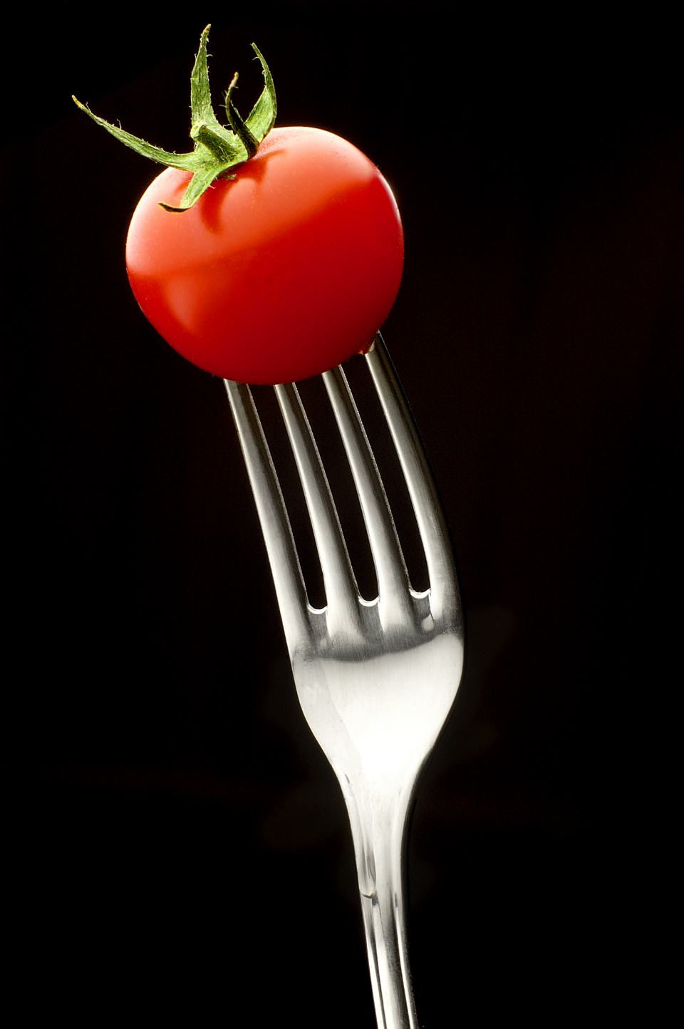tomato fork red black background food tasteful tasty fresh vegetable health raw cherry tomato
