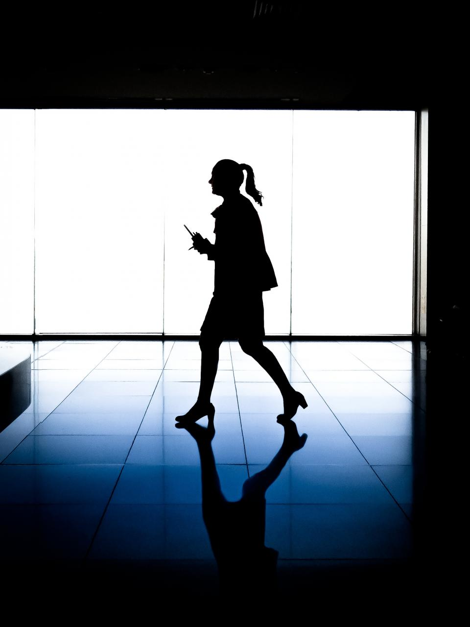 dark silhouette lights floor reflection people woman girl female business office