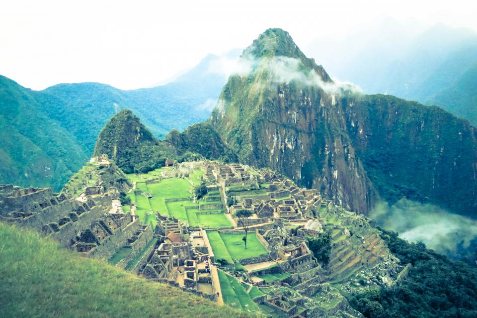 Machu Picchu Peru landscape nature green grass mountains peaks valleys hills trees