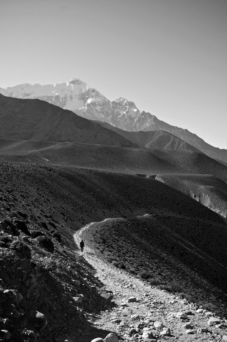 nepal black and white walking stones gravel mountains hills dirt