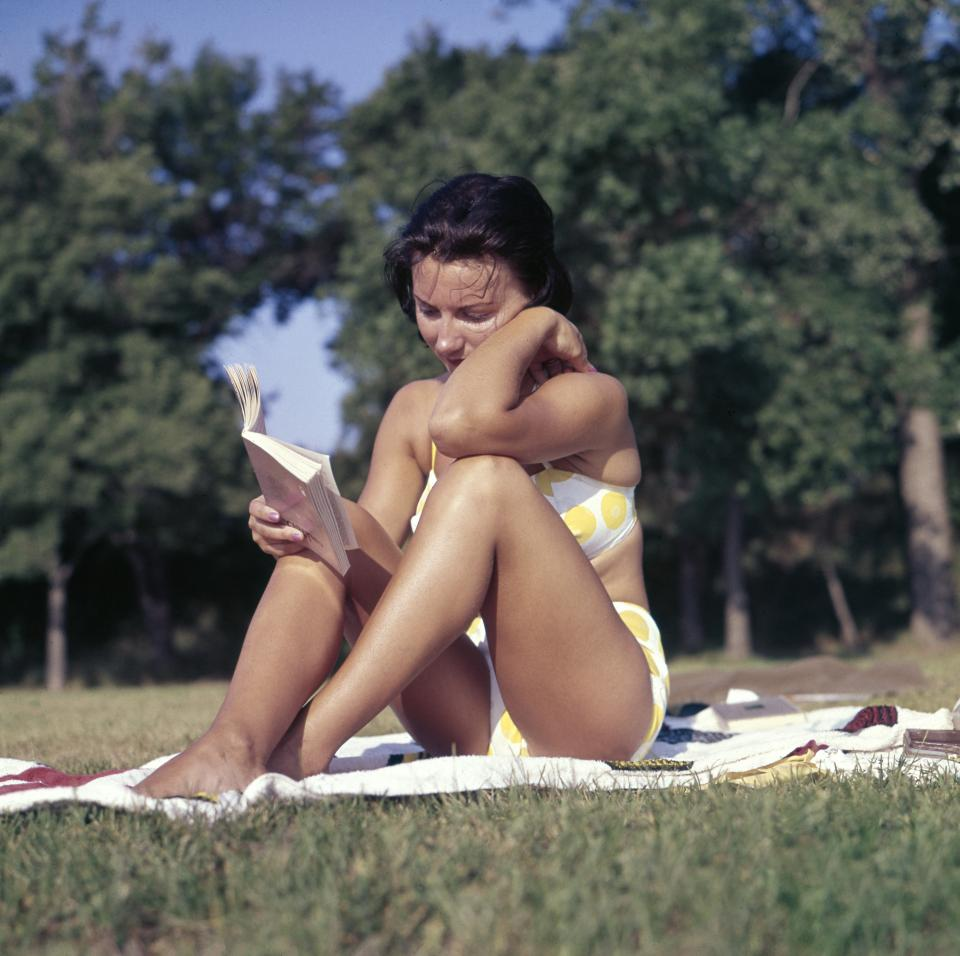 people woman girl female swimsuit sexy suntan reading book picnic grass sunny day summer plant trees nature