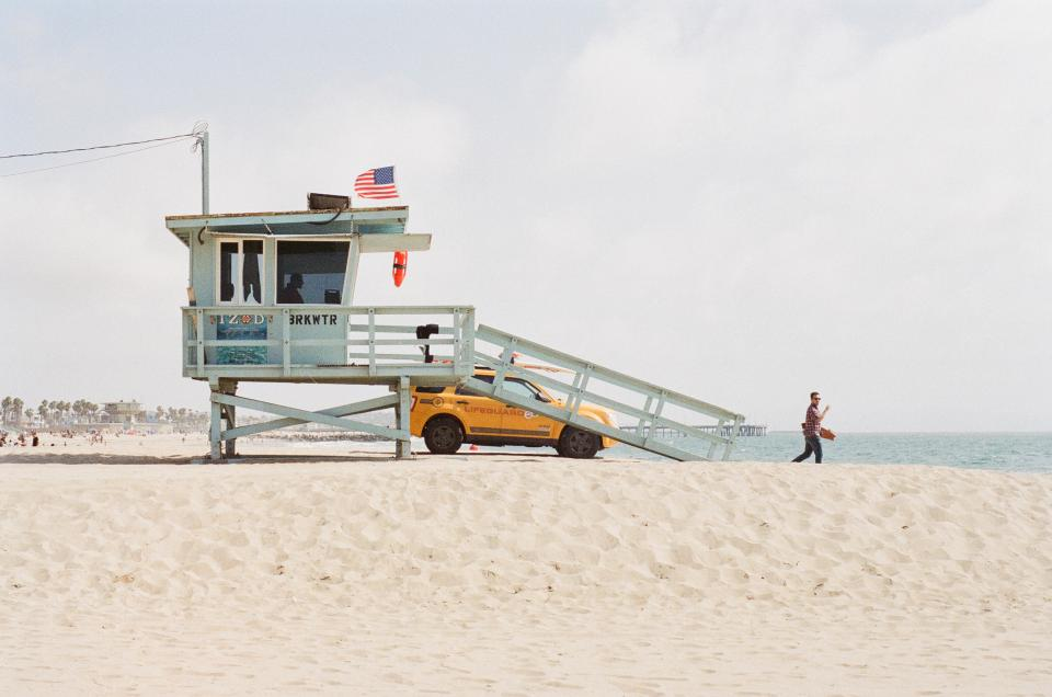 beach sand lifeguard truck suv flag usa american ocean man sunshine summer venice