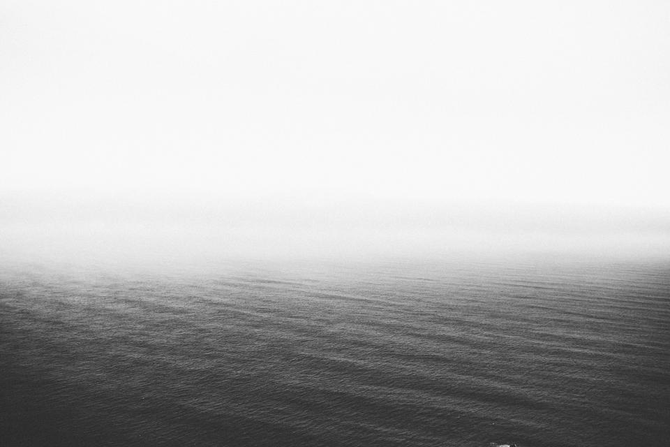black and white sky water