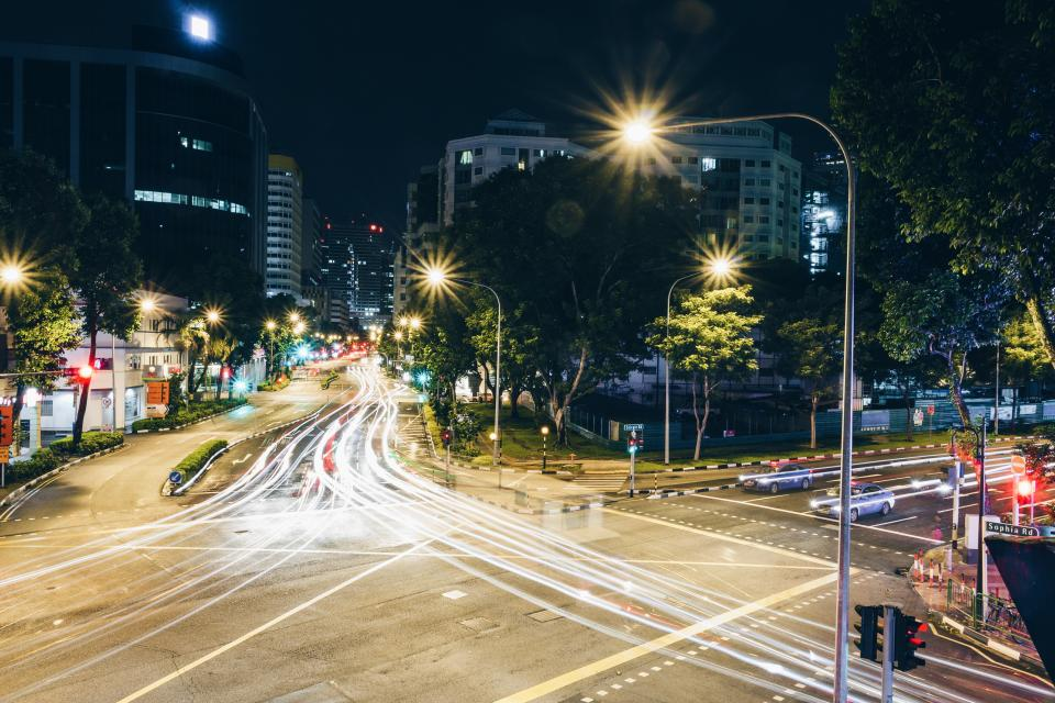 street road traffic lights car vehicle transportation building structure architecture trees nature view city dark night pole