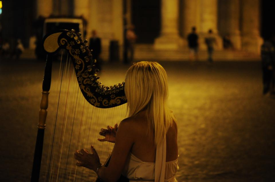musician music harp instrument girl woman blonde street