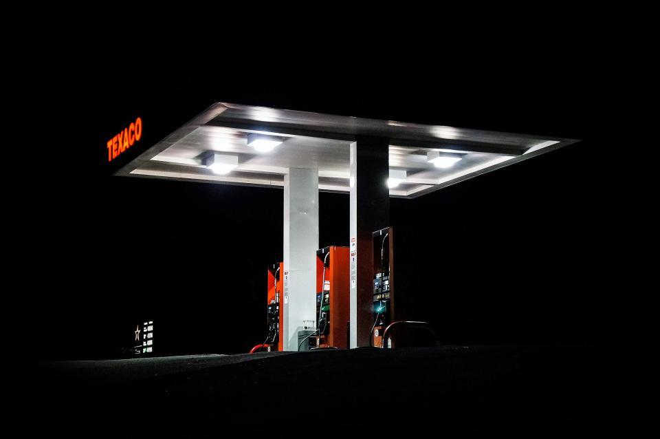 dark night gas station texaco company