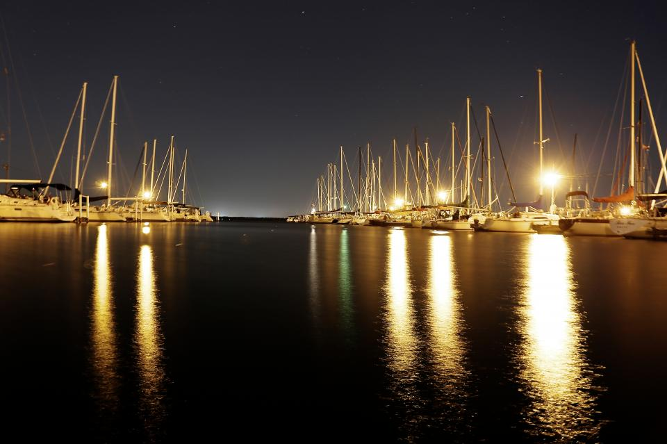 sailboats water pier port docks lights night dark