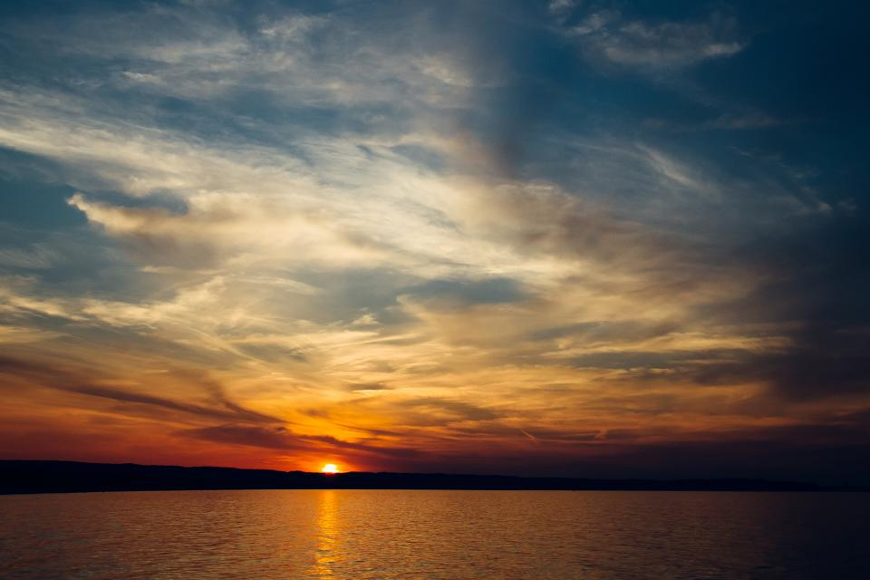 sunset dusk sky clouds horizon lake water landscape nature outdoors