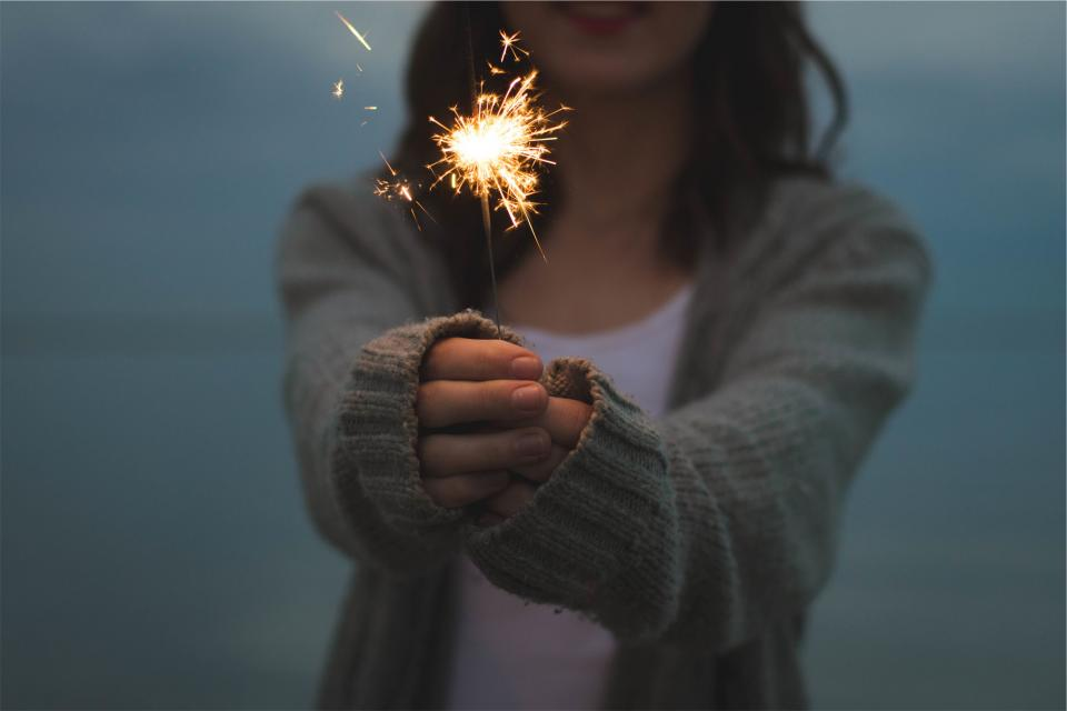 sparkler hands cardigan sweater girl woman people