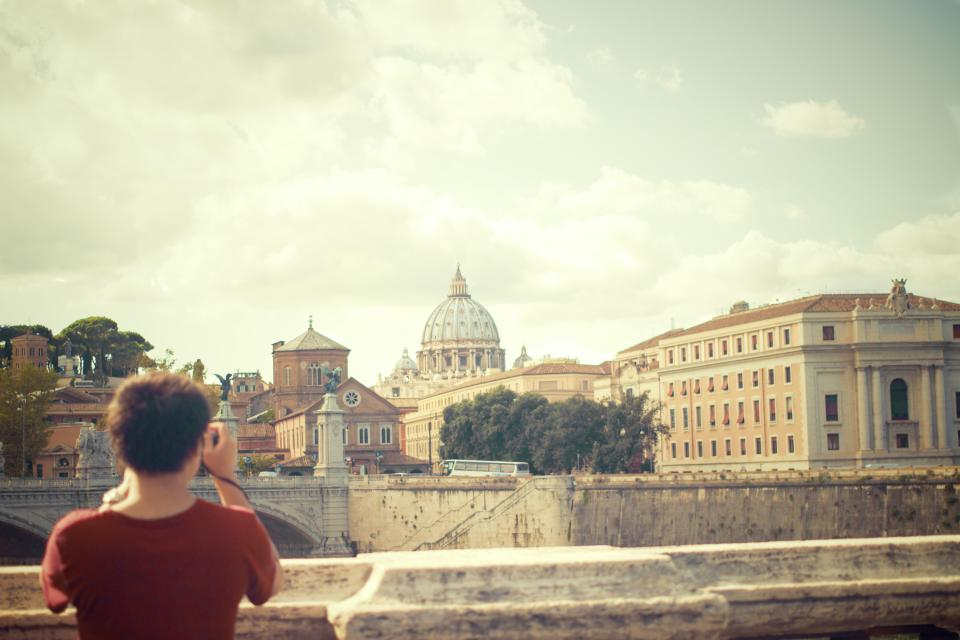 Vatican city Rome Ponte-Sant'Angelo woman girl photographer tourist architecture buildings people