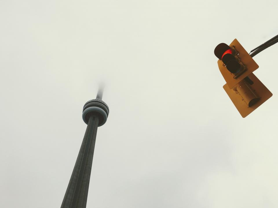architecture building infrastructure structure cn tower stop light clouds sky