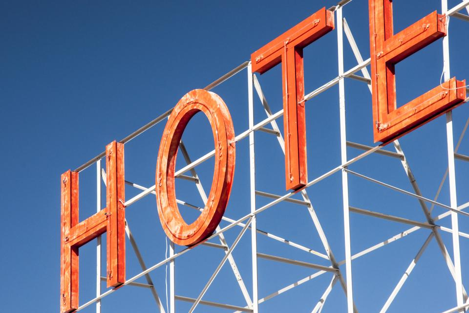 hotel sign letters orange blue sky