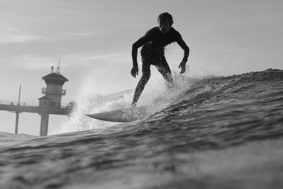 black and white guy man surfing sport waves bridge sky clouds beach summer adventure splash