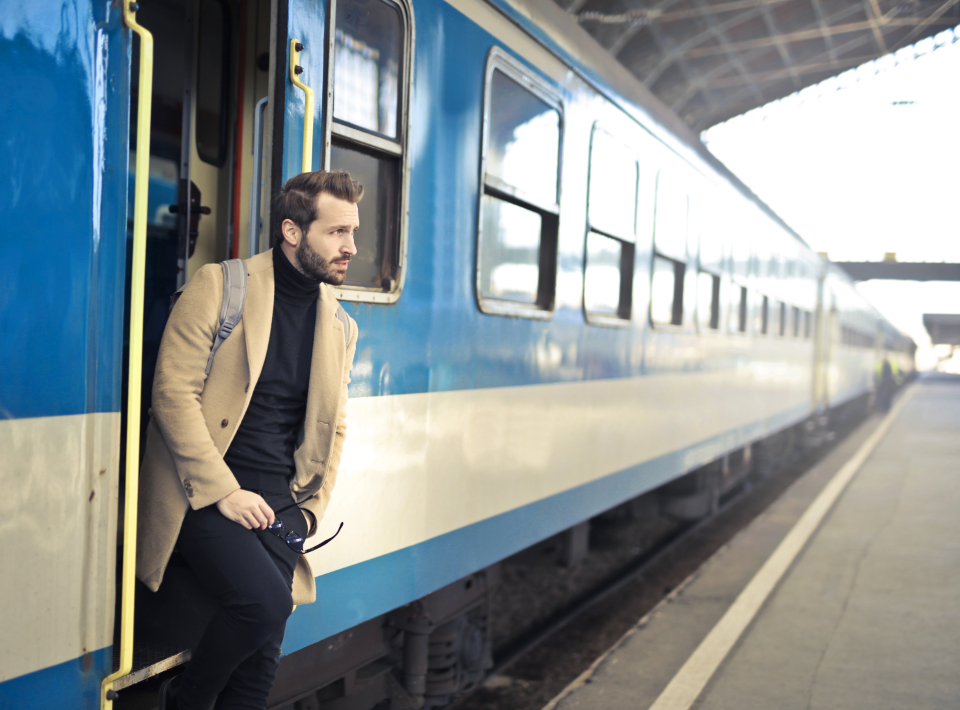 man exiting train transport platform station blue business beard people