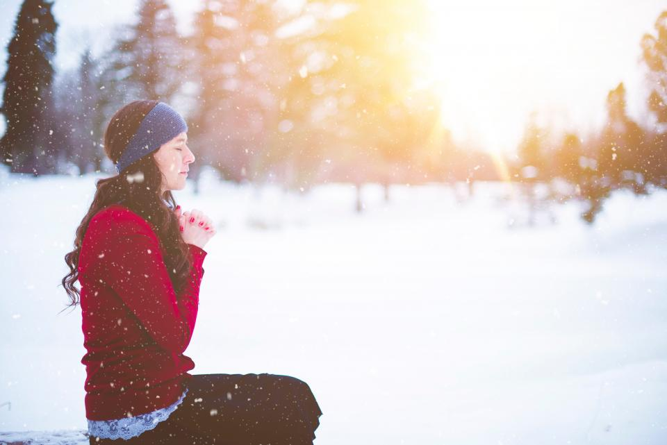people girl woman female snow winter outdoor outside cold weather blur praying