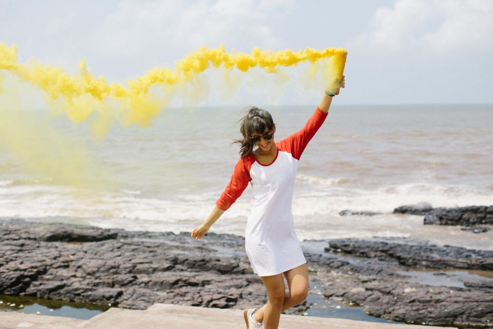 people woman happy fun smoke yellow beach ocean sea waves travel adventure clouds sky vacation