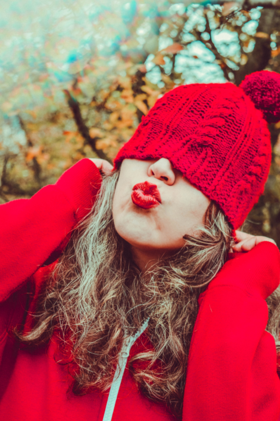 woman red hat kiss nature outdoors pose funny silly portrait person autumn
