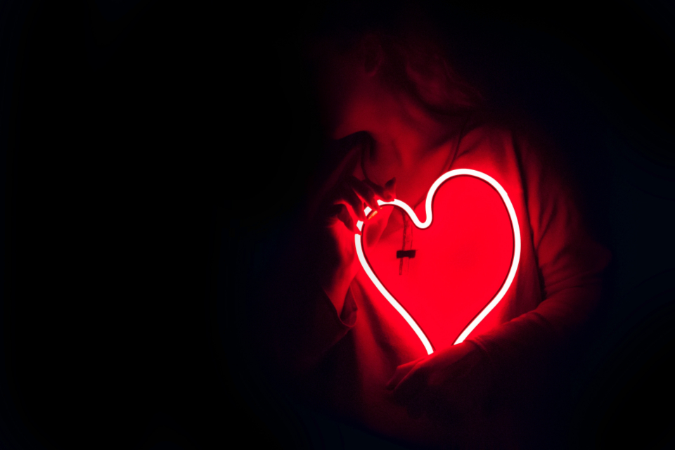 red neon heart light woman female girl dark shadow
