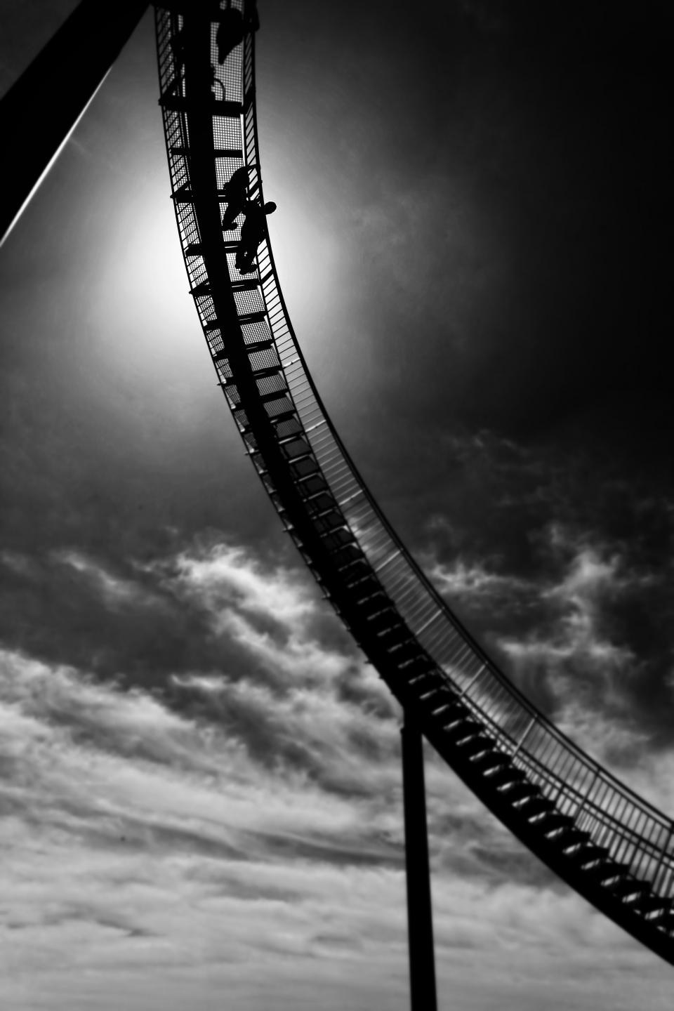 clouds sky black and white stairs architecture structure people silhouette roller coaster ride adventure