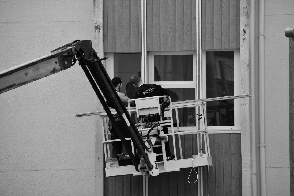people man men guy working cleaner soudal black and white belgium building window glass steel establishment