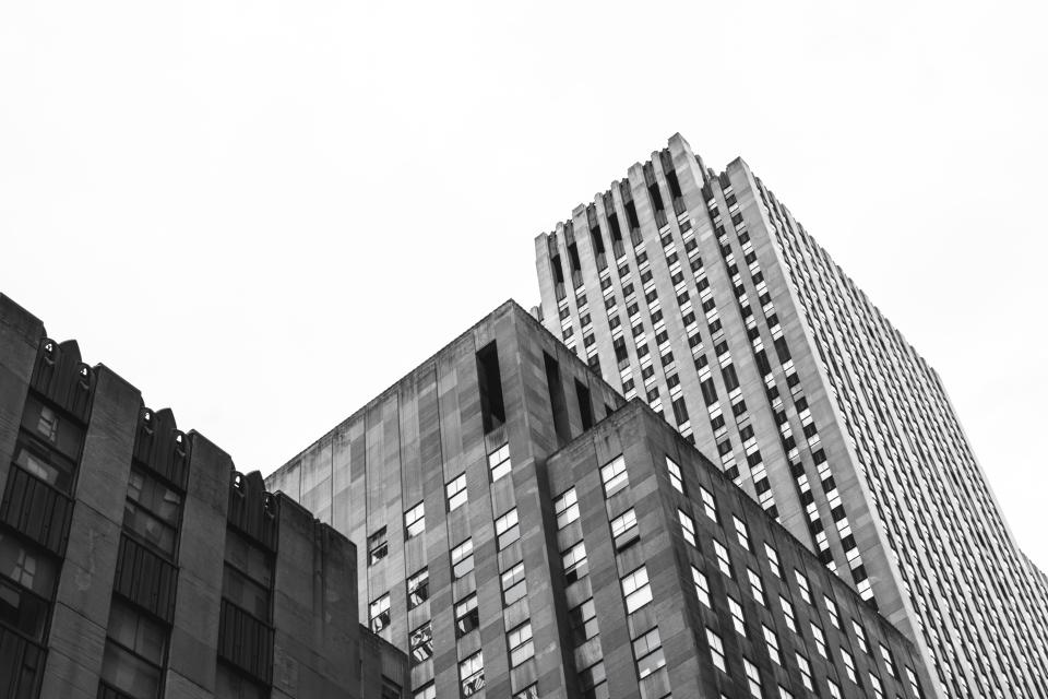 buildings architecture downtown city urban high rises windows business corporate sky black and white