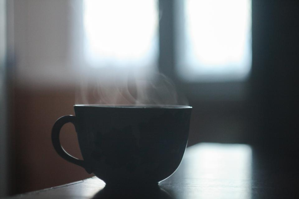 black cup mug coffee drink hot blur table window