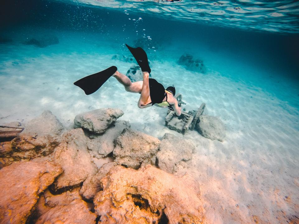 sea ocean blue water nature rock underwater people man swimming scuba diving