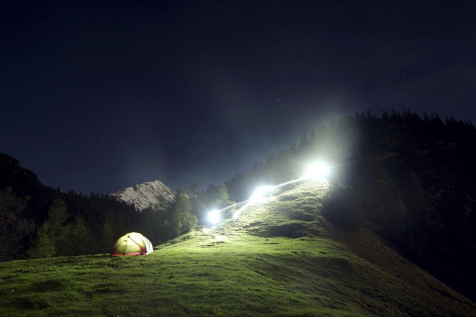 mountain highland dark sky landscape nature valley hill camping tent light green grass trees stars night view travel