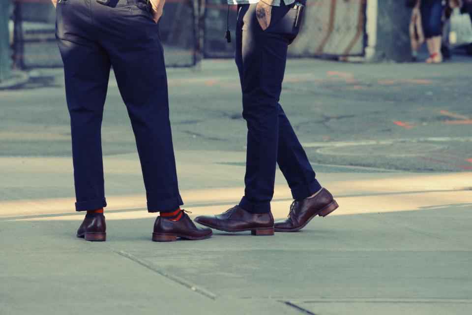 pants shoes sidewalk city people fashion friends